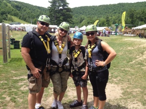 Jim, Tami, Marcus and Lexi in all the safety harnesses getting ready to go up the mountain.