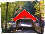 How can you resist the brilliant red color of a covered bridge?